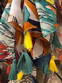 Colorful silk scarvers hanging on market stall