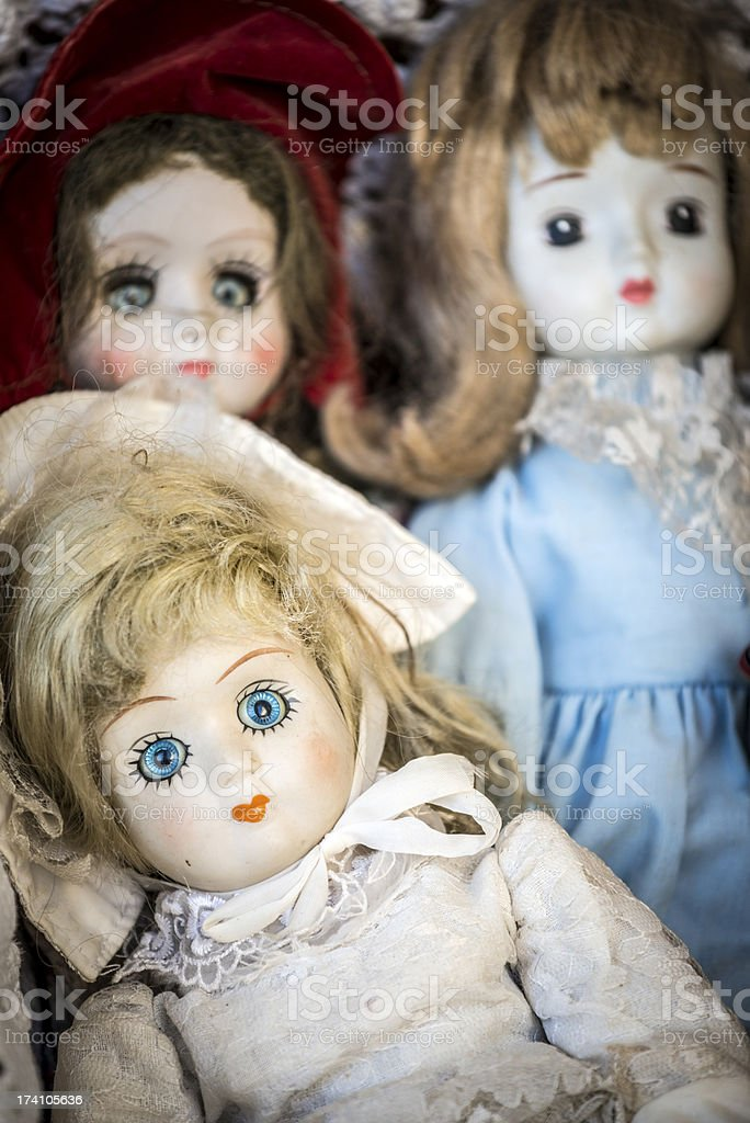 Scary antique doll and puppets in flea market royalty-free stock photo
