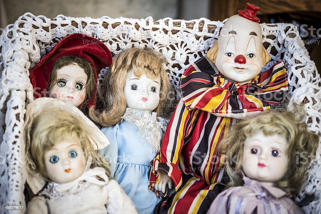 Scary antique doll and puppets in flea market stock photo