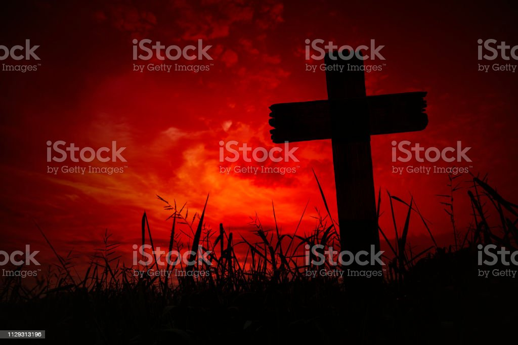 Scary Background Cemetery Cross With Dark Silhouette In