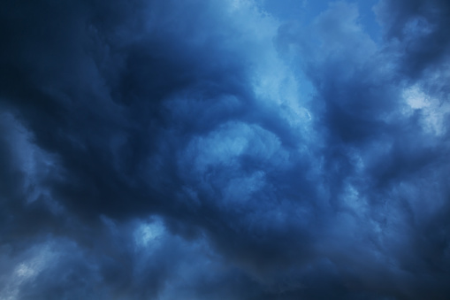 Scary background of blue sky with menacing clouds, concept of horror and Halloween