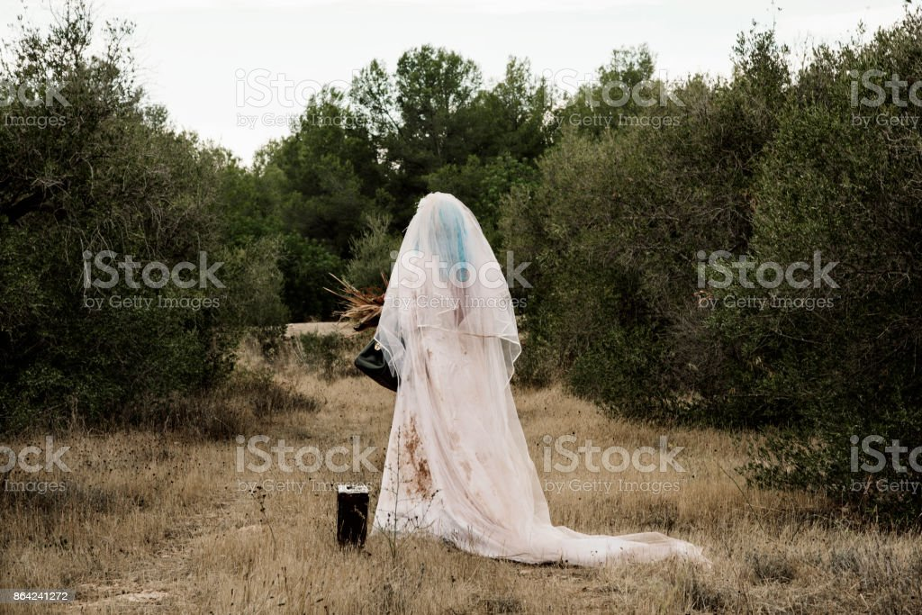 scary bride seen from behind outdoors royalty-free stock photo