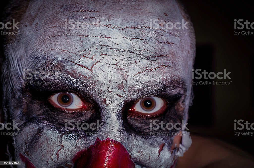 scary clown face isolated on black background colour image, horror stock photo