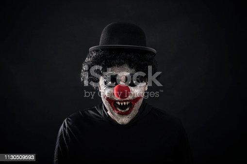 Scary clown showing his sharp pointy teeth