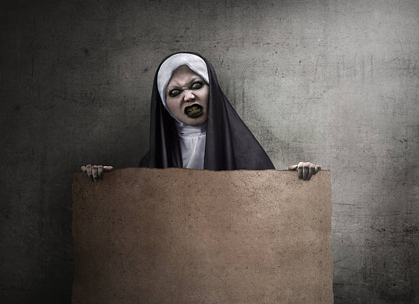 scary devil nun - demoniac stock pictures, royalty-free photos & images