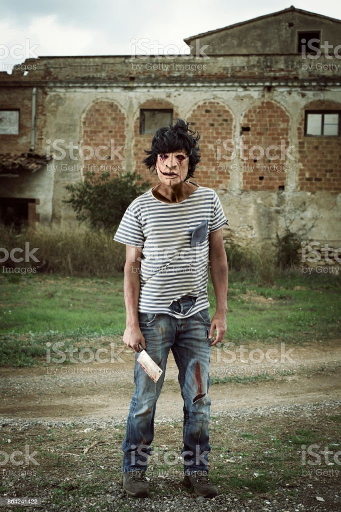 scary disfigured man with a cleaver royalty-free stock photo