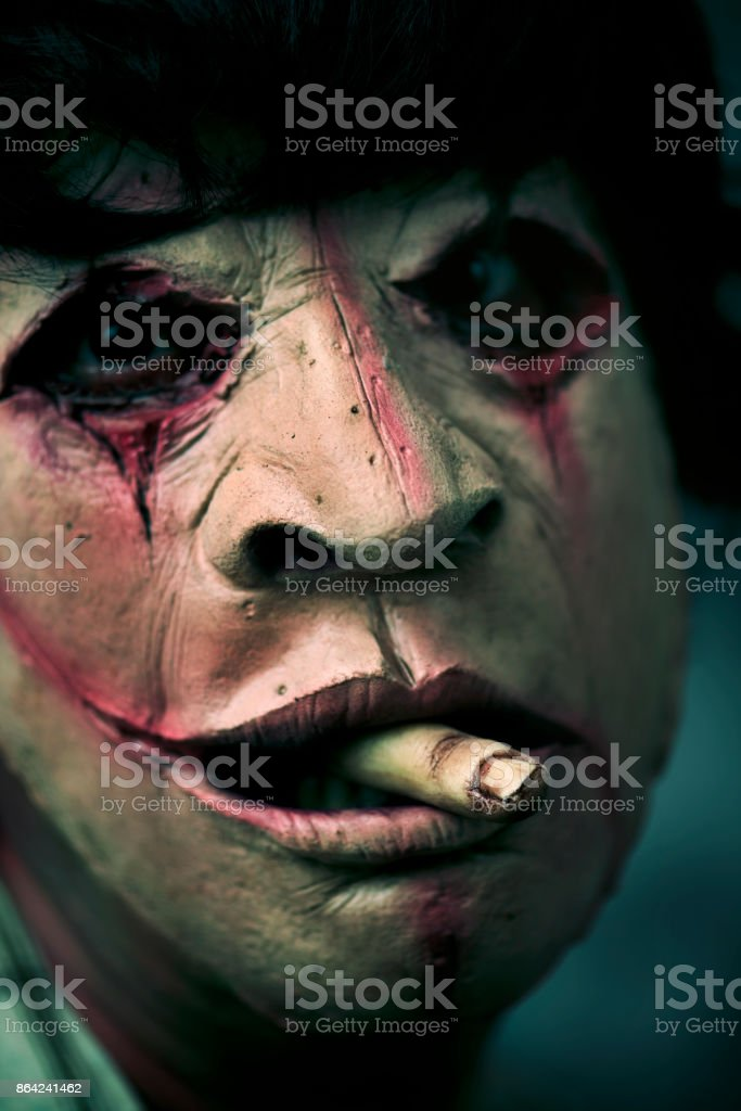 scary disfigured man with a finger in his mouth royalty-free stock photo