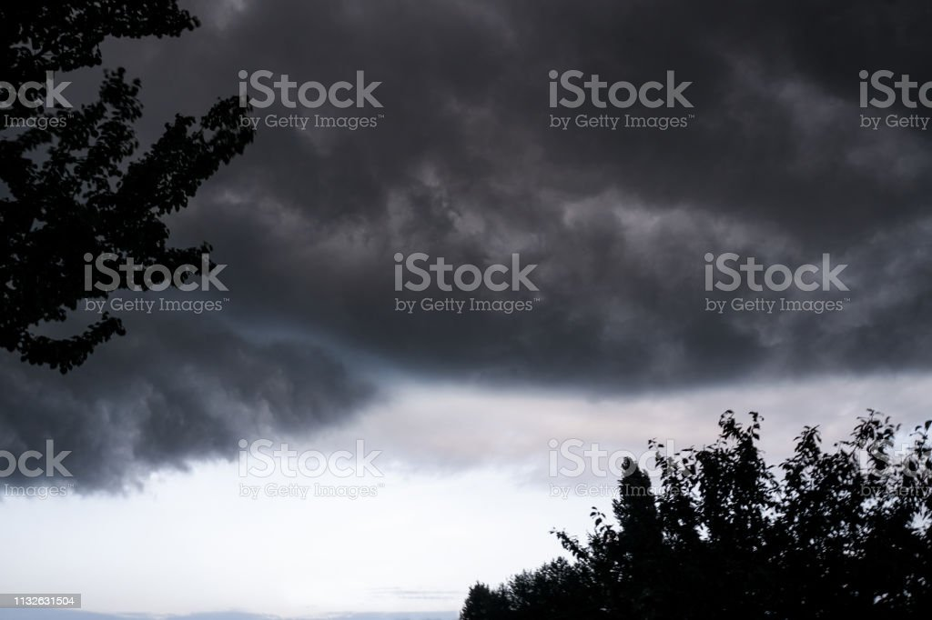 Scary epic sky with menacing clouds. Hurricane wind with a...