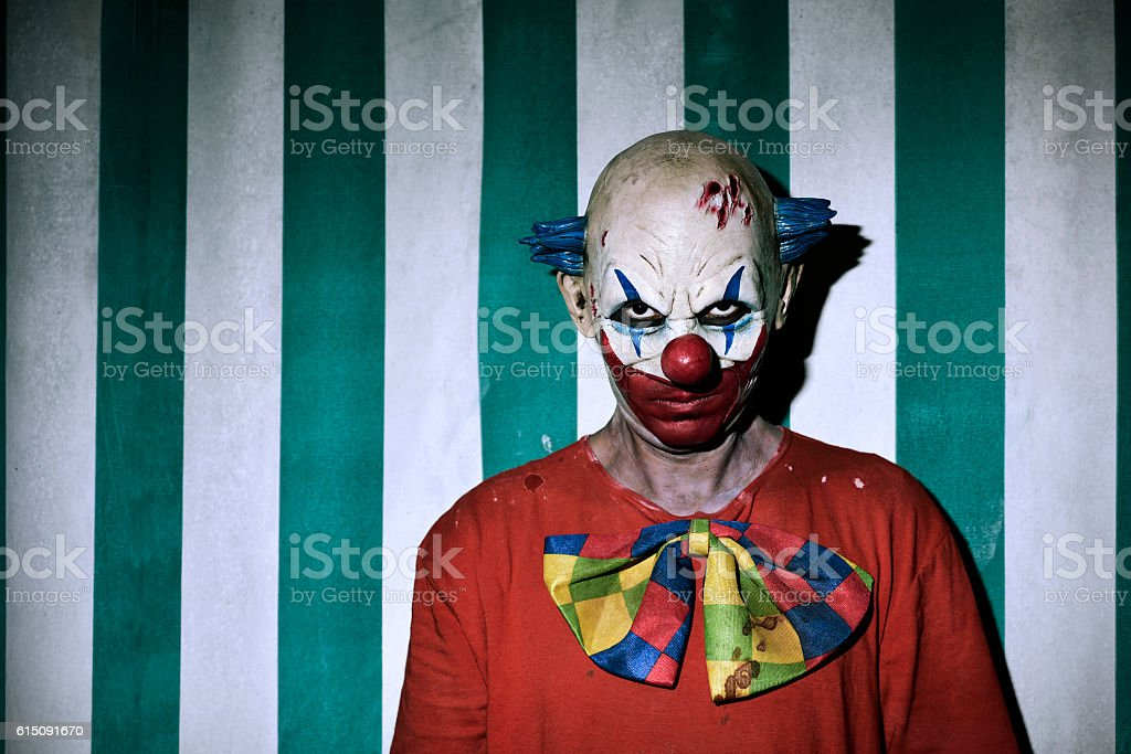 scary evil clown in the circus stock photo
