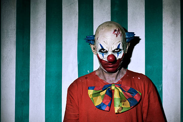 scary evil clown in the circus - foto de stock