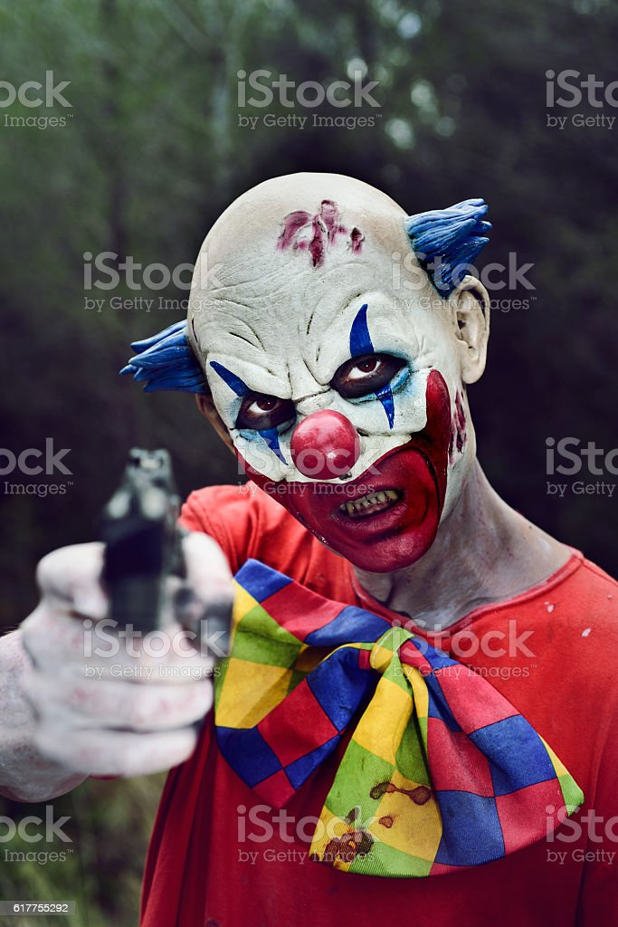 Scary Evil Clown With A Gun Stock Photo Download Image Now Istock