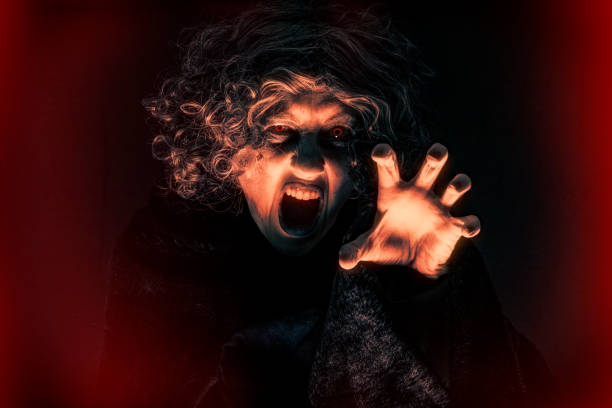 Scary Evil Witchy Woman A creepy image of an angry woman full of evil rage. sdominick stock pictures, royalty-free photos & images