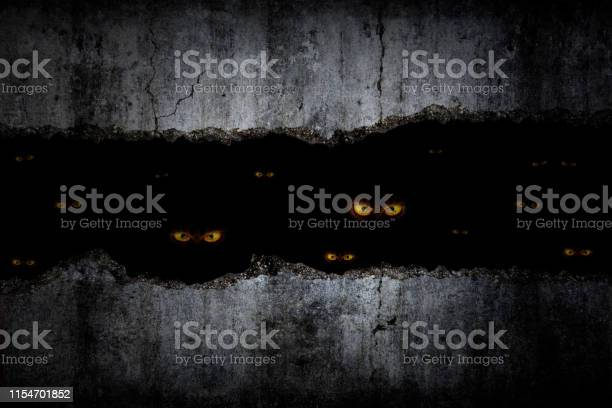 Scary eyes in damaged grungy crack and broken concrete wall and the picture id1154701852?b=1&k=6&m=1154701852&s=612x612&h=q8mpep3ngocbdt1byytir5kqa0yypbgjhkodaosrlps=