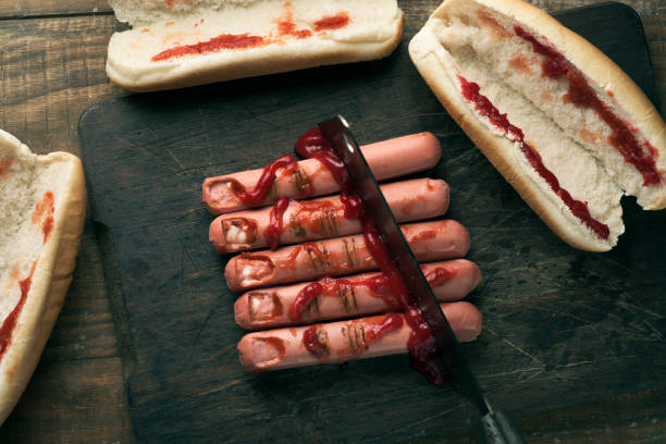 scary finger-shaped hotdogs stock photo