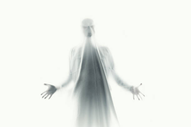 scary ghost in a white sheet stock photo