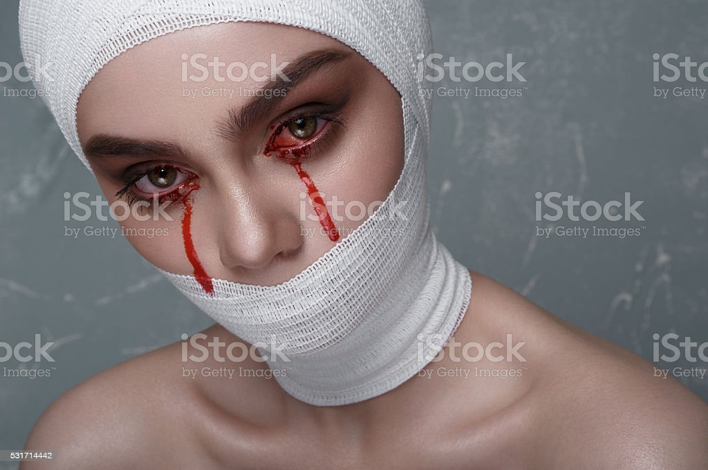 Scary Girl with Blood from her Eyes stock photo