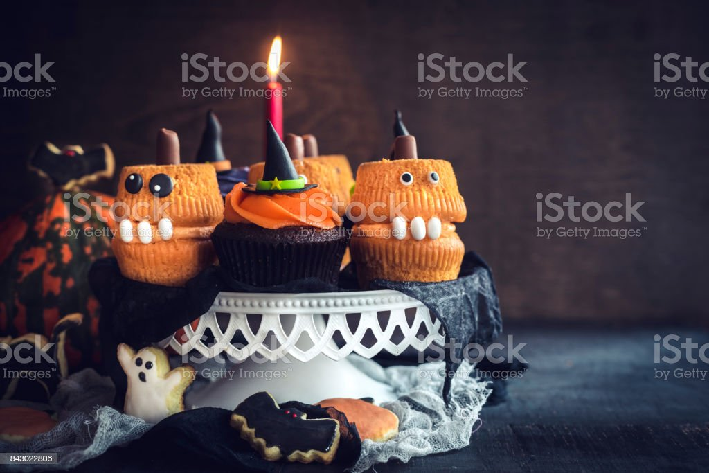 Scary Halloween cup cakes stock photo