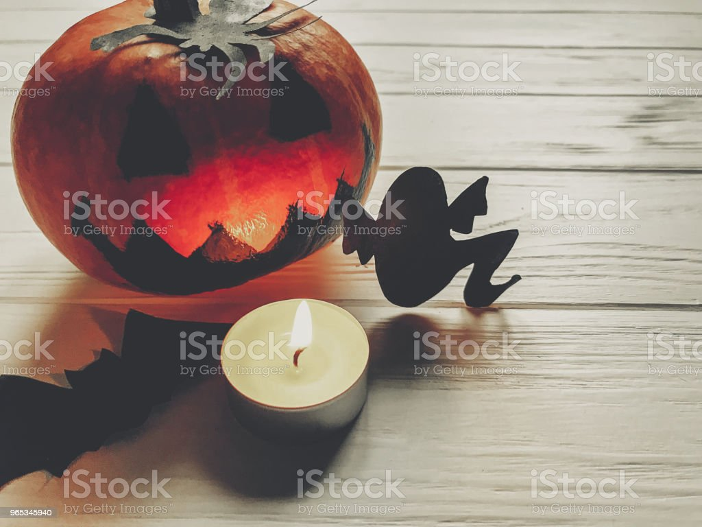 scary halloween. dark spooky jack lantern pumpkin with ghost bats and spider black decorations with candle light on wooden background. holiday celebration. seasonal greetings. happy halloween zbiór zdjęć royalty-free