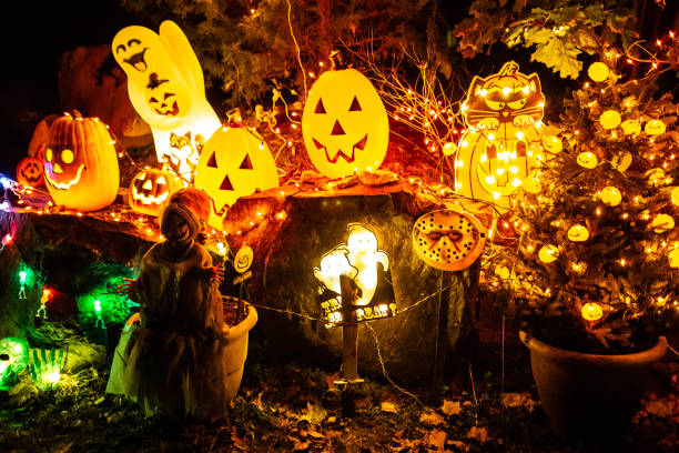 Scary halloween decorations outdoors at night close up stock photo
