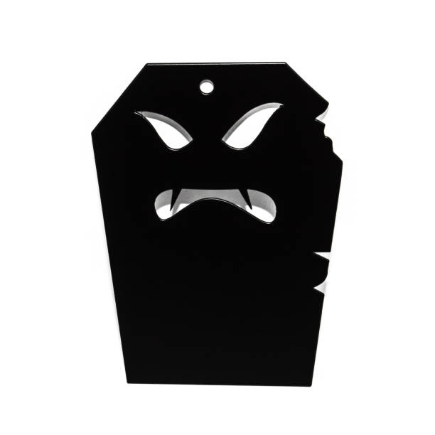 A scary Halloween tombstone over a white background stock photo