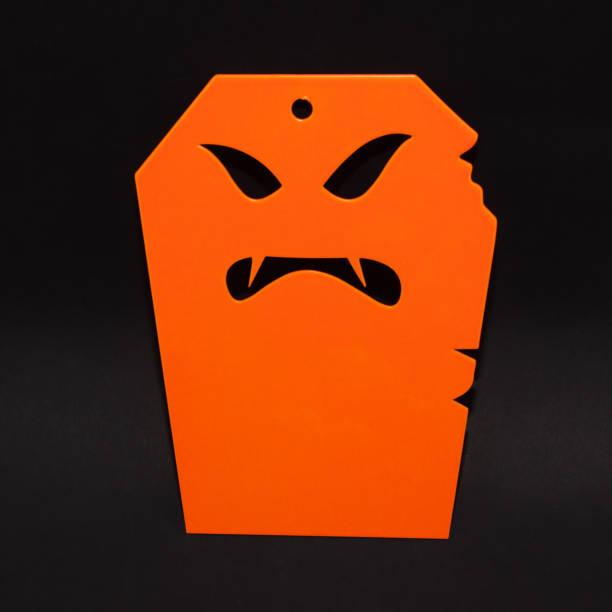 A scary Halloween tombstone over black background stock photo