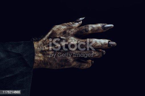 Scary hand on dark background. Halloween theme.