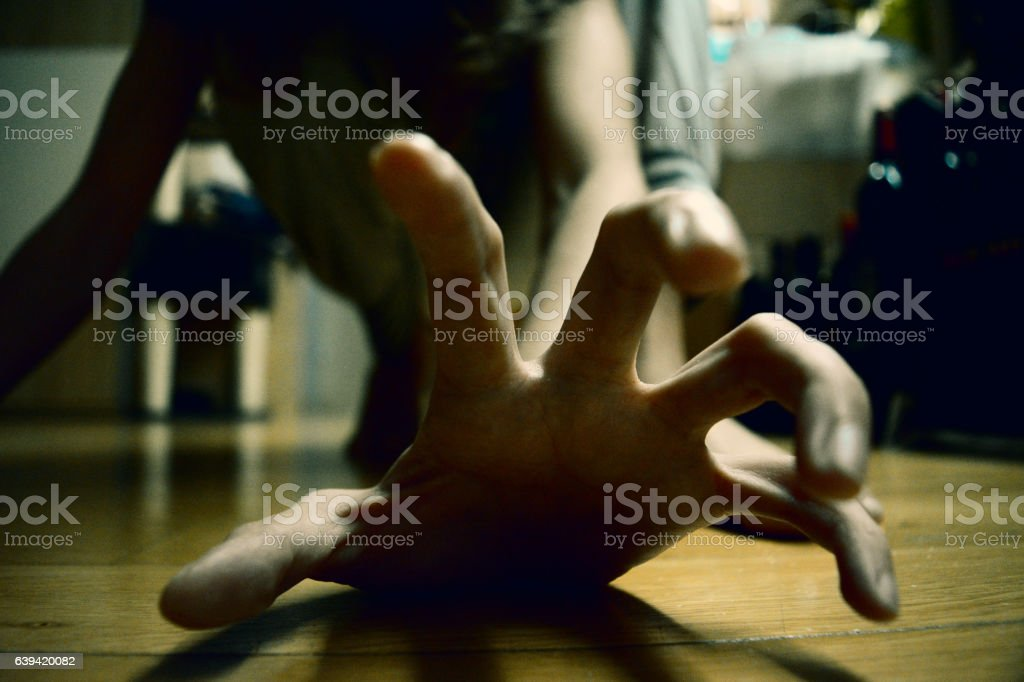 Scary hand A scary hand reaching out Abuse Stock Photo