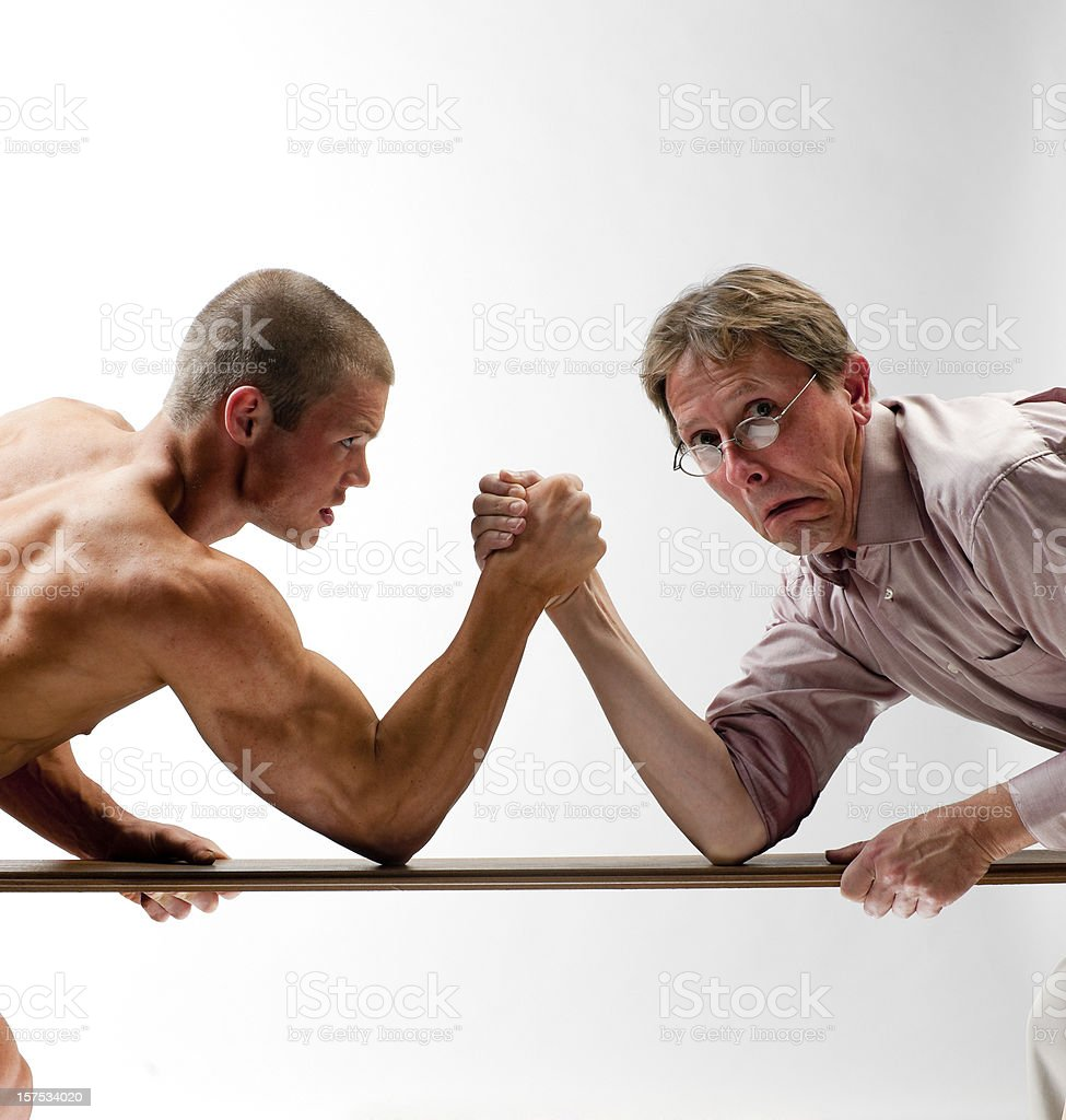 scary man arm wrestling stock photo