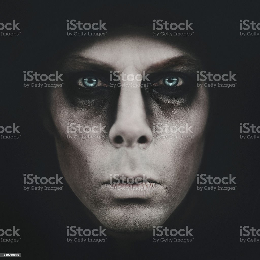 Scary man coming out of the dark stock photo