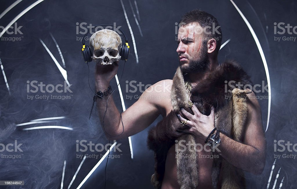 Scary man in a bear coat with scar stock photo