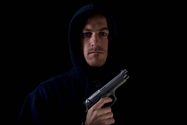 Scary man with a gun stock photo