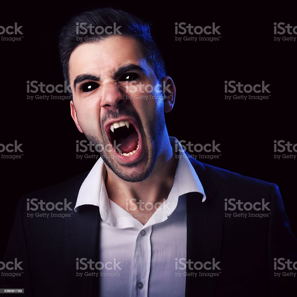 Scary man with black eyes and fangs stock photo