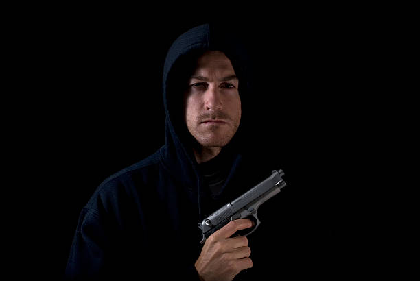 Scary man with gun stock photo