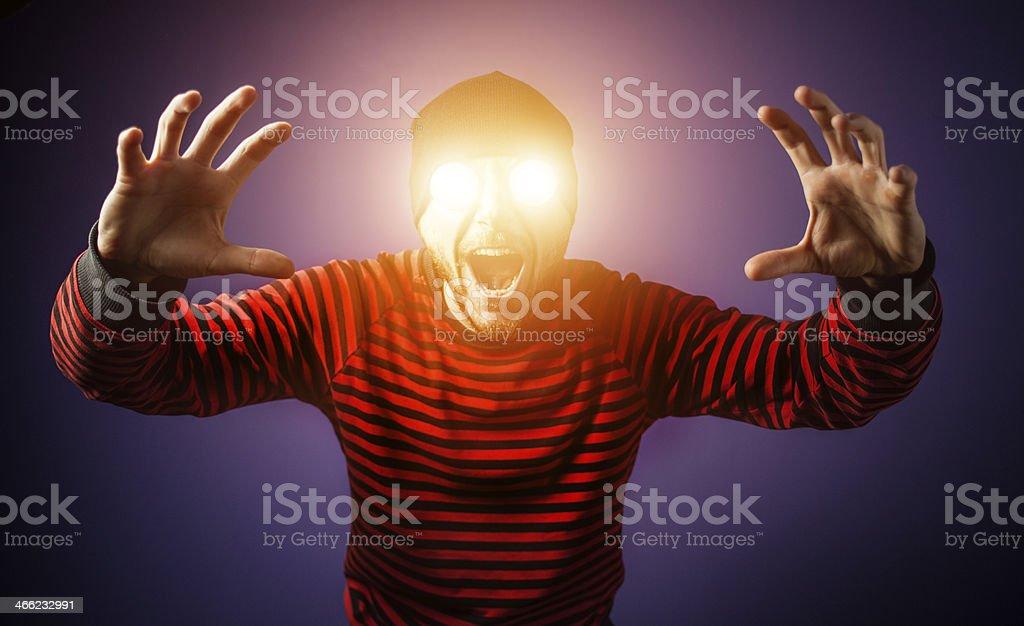 Scary man with luminous eyes stock photo