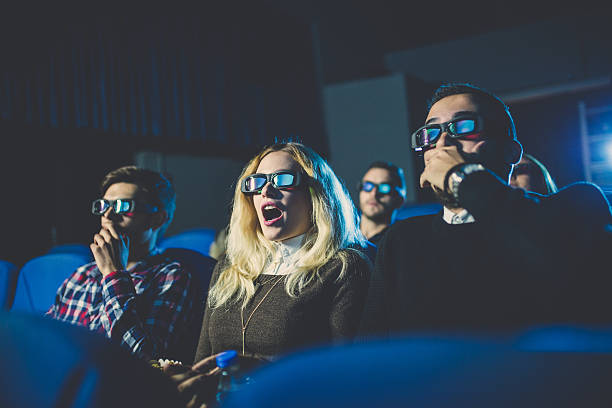 Scary movie Friends watching a horror movie in a movie theater, getting scared and screaming. 3 d glasses stock pictures, royalty-free photos & images