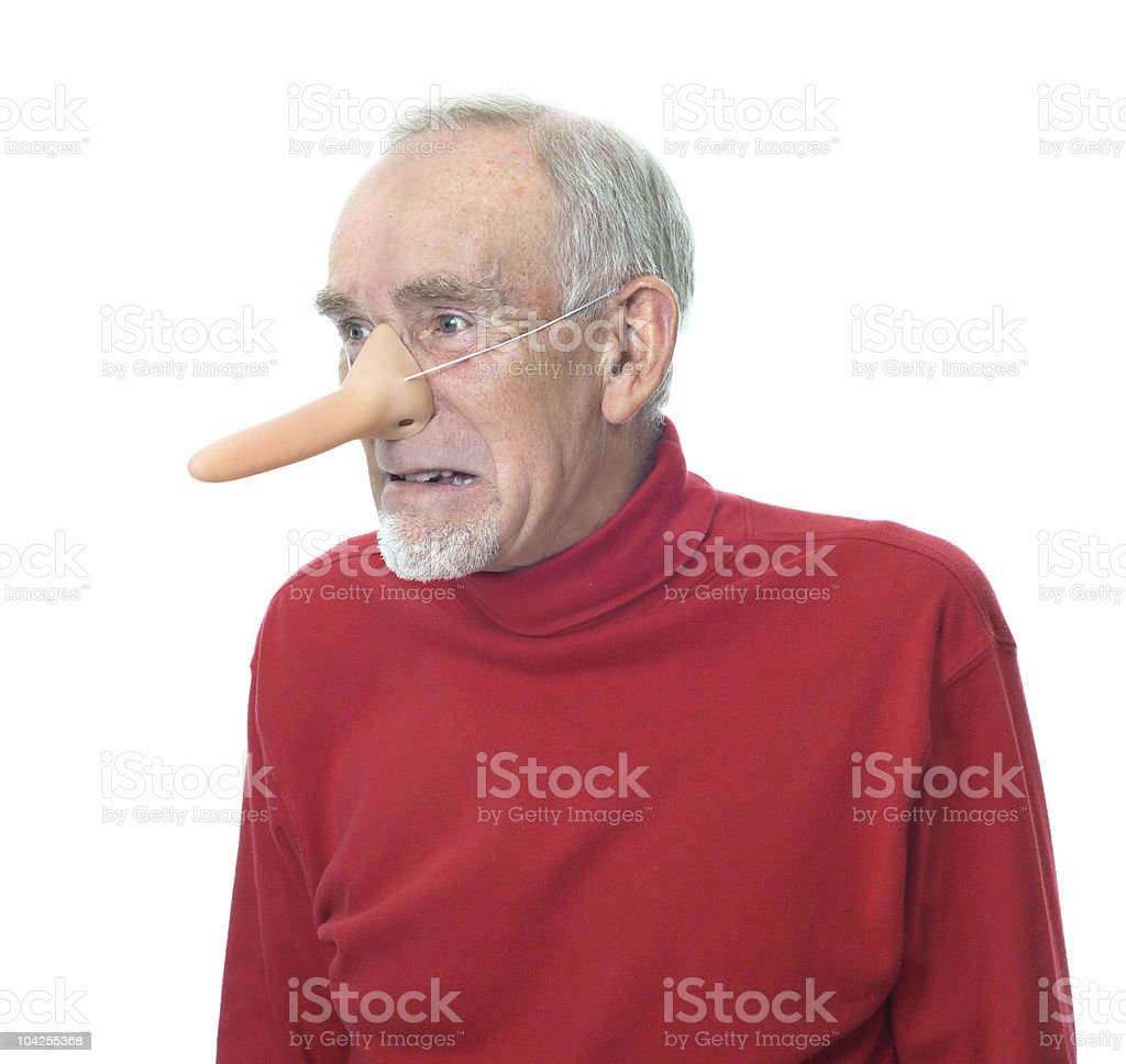 Scary old man wearing long rubber nose royalty-free stock photo