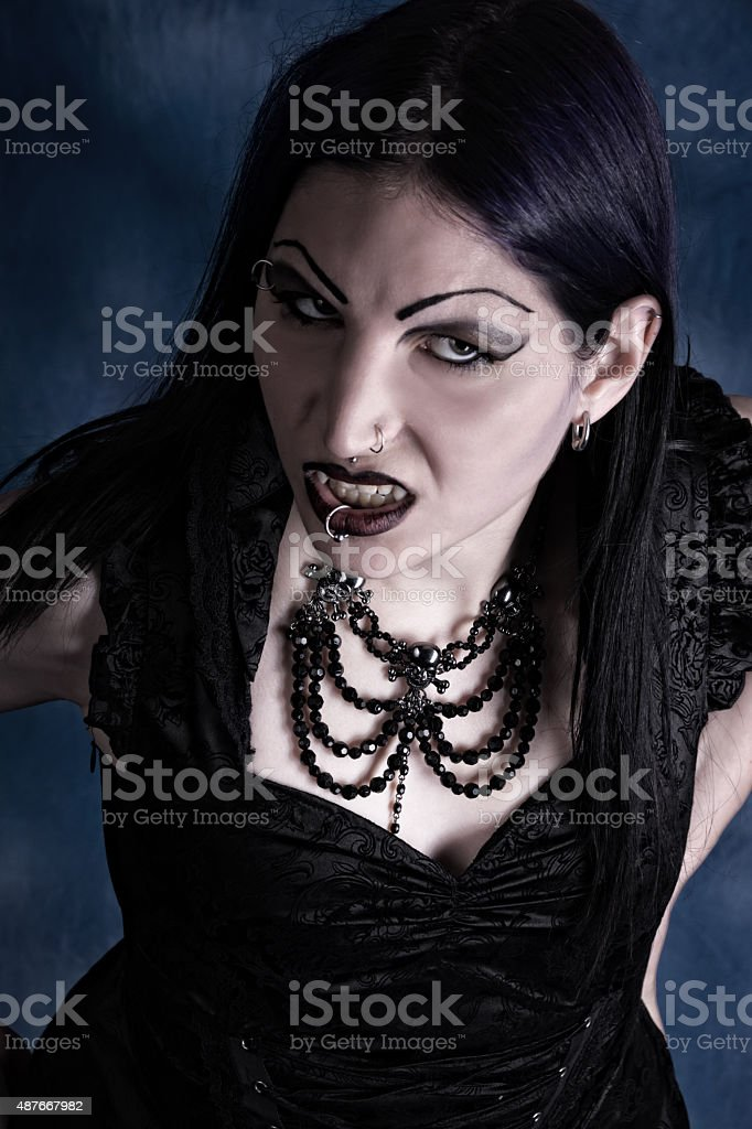 Scary overhead shot of snarling Vampire looking at camera. stock photo