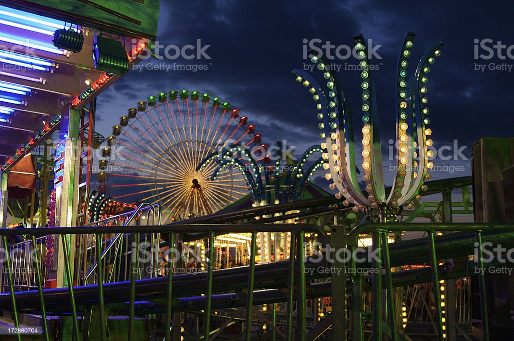 Scary Roller Coaster Rumbles Through Deserted Theme Park, Storm Approaches stock photo