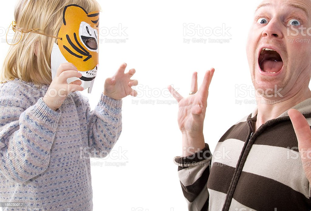 scary shock surprise tiger mask stock photo