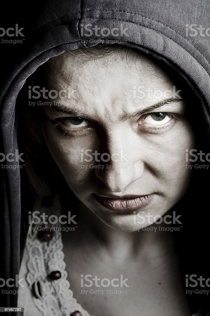 Scary sinister woman with spooky evil eyes royalty-free stock photo