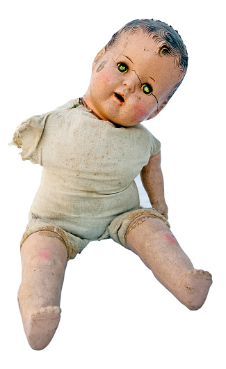 Scary spooky vintage doll baby. Isolated. Vertical.