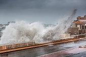 Marseille Corniche Kennedy big waves splash against road and cars