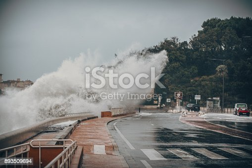 istock Scary Stormy Background With Big Sea Wave Splash Against City Road 893509694