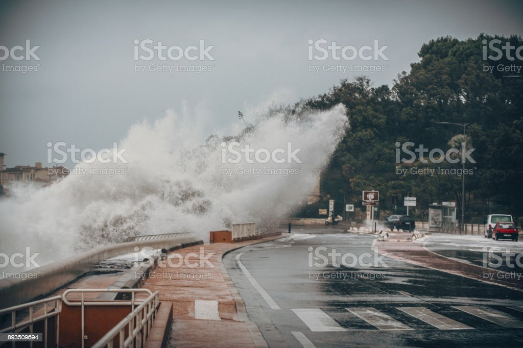 Scary Stormy Background With Big Sea Wave Splash Against City Road stock photo