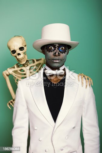 Sugar skull man with his buddy the skeleton