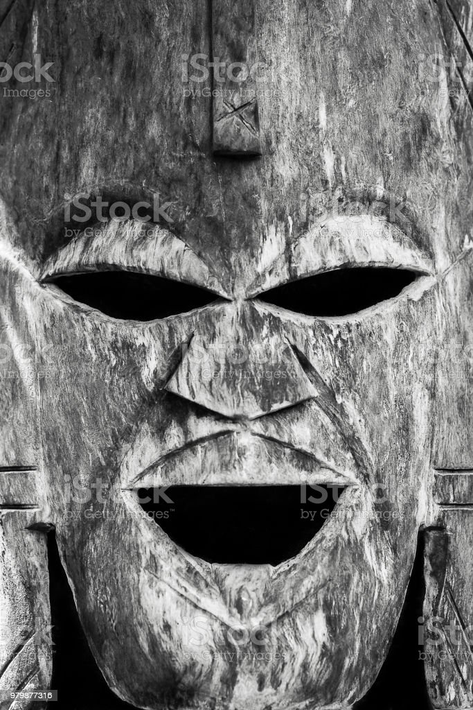 Scary wooden totem voodoo mask stock photo