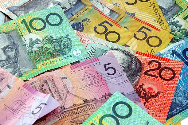 Scattered Australian Cash Australian notes scattered on a table. Click to see more... australian culture stock pictures, royalty-free photos & images