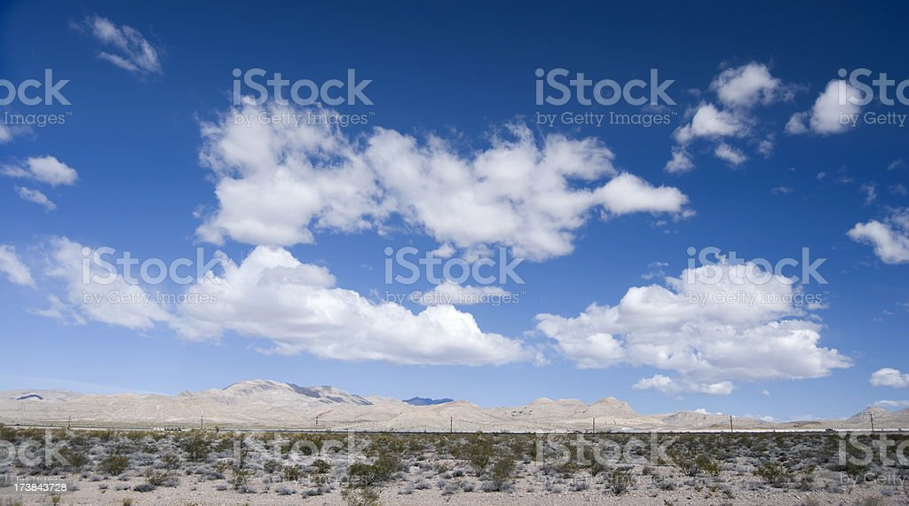 Scattered clouds in the desert royalty-free stock photo