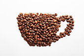 istock Scattered coffee beans frame design on copy space background. 1128154626