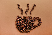 istock Scattered coffee beans frame design on copy space background. 1139973033